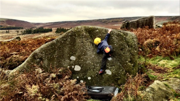 bouldering outside boy Iain Mckenzie